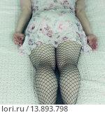 Купить «a woman in a negligee is lying on a bed.», фото № 13893798, снято 19 апреля 2019 г. (c) age Fotostock / Фотобанк Лори