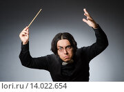 Купить «Funny conductor in musical concept», фото № 14022654, снято 1 августа 2015 г. (c) Elnur / Фотобанк Лори