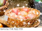 Купить «ripe pomegranates in basket at food market», фото № 14122110, снято 20 декабря 2014 г. (c) Syda Productions / Фотобанк Лори