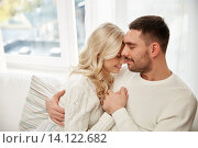 Купить «happy couple covered with plaid on sofa at home», фото № 14122682, снято 8 октября 2015 г. (c) Syda Productions / Фотобанк Лори