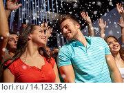 Купить «smiling friends at concert in club», фото № 14123354, снято 20 октября 2014 г. (c) Syda Productions / Фотобанк Лори
