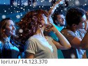 Купить «happy friends dancing at night club», фото № 14123370, снято 20 октября 2014 г. (c) Syda Productions / Фотобанк Лори