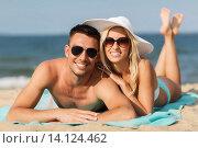 Купить «happy couple in swimwear lying on summer beach», фото № 14124462, снято 11 августа 2015 г. (c) Syda Productions / Фотобанк Лори