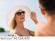 Купить «happy couple sunbathing on summer beach», фото № 14124470, снято 11 августа 2015 г. (c) Syda Productions / Фотобанк Лори