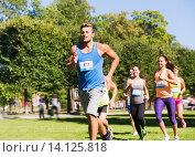 Купить «happy young sportsmen racing wit badge numbers», фото № 14125818, снято 16 августа 2015 г. (c) Syda Productions / Фотобанк Лори