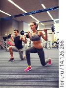 Купить «young man and woman training with barbell in gym», фото № 14126266, снято 30 ноября 2014 г. (c) Syda Productions / Фотобанк Лори