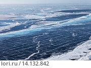 Купить «Вид сверху на неоднородный лед озера Байкал. Трещины, разломы и опасные участки тонкого льда. Ледовый фон», фото № 14132842, снято 9 марта 2015 г. (c) Виктория Катьянова / Фотобанк Лори
