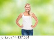 Купить «smiling young woman in blank white shirt and jeans», фото № 14137534, снято 30 июля 2012 г. (c) Syda Productions / Фотобанк Лори
