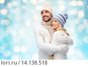 Купить «happy couple in winter clothes hugging over lights», фото № 14138518, снято 8 октября 2015 г. (c) Syda Productions / Фотобанк Лори