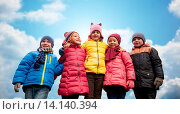 Купить «happy children hugging over blue sky background», фото № 14140394, снято 10 октября 2015 г. (c) Syda Productions / Фотобанк Лори