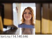 Купить «happy student girl or woman with book in library», фото № 14140646, снято 6 марта 2015 г. (c) Syda Productions / Фотобанк Лори