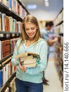 Купить «happy student girl or woman with book in library», фото № 14140666, снято 6 марта 2015 г. (c) Syda Productions / Фотобанк Лори