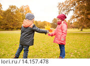 Купить «little boy giving autumn maple leaves to girl», фото № 14157478, снято 10 октября 2015 г. (c) Syda Productions / Фотобанк Лори
