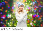 smiling young woman in winter hat and sweater. Стоковое фото, фотограф Syda Productions / Фотобанк Лори