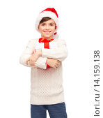 Купить «smiling happy boy in santa hat with gift box», фото № 14159138, снято 6 ноября 2015 г. (c) Syda Productions / Фотобанк Лори