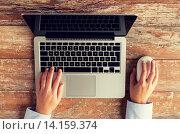 Купить «close up of female hands with laptop and mouse», фото № 14159374, снято 10 октября 2014 г. (c) Syda Productions / Фотобанк Лори