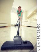 Купить «happy woman with vacuum cleaner at home», фото № 14159450, снято 25 января 2015 г. (c) Syda Productions / Фотобанк Лори