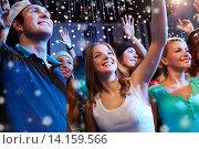 Купить «smiling friends at concert in club», фото № 14159566, снято 20 октября 2014 г. (c) Syda Productions / Фотобанк Лори
