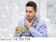 Купить «ill man with flu drinking tea and coughing at home», фото № 14159754, снято 29 января 2015 г. (c) Syda Productions / Фотобанк Лори