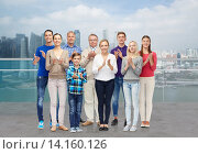 group of people applauding over city waterside. Стоковое фото, фотограф Syda Productions / Фотобанк Лори