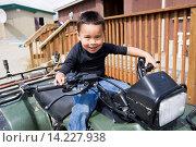 Купить «A Young Boy Smiles Playfully While Sitting Atop A Four Wheeler And Holding The Handlebars; Igiugig Bristol Bay Alaska United States Of America», фото № 14227938, снято 16 февраля 2019 г. (c) age Fotostock / Фотобанк Лори