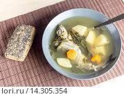 Купить «Рыбный суп из лаврака с сельдереем», фото № 14305354, снято 30 ноября 2015 г. (c) Татьяна Ляпи / Фотобанк Лори