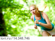 Купить «Woman Running Outdoors in Forest», фото № 14348746, снято 18 января 2019 г. (c) age Fotostock / Фотобанк Лори