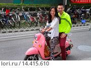 Купить «China, Beijing, Guang An Men Nei Da Jie, Guanganmen Outer Street, Asian, man, woman, couple, electric motor scooter, pink, riding,.», фото № 14415610, снято 16 сентября 2013 г. (c) age Fotostock / Фотобанк Лори