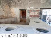 Купить «Casa e Thermopolium di Vetutius Placidus, Thermopolium of Vetutius Placidus, Scavi di Pompei, Pompeii Ruins, Pompei, Naples, Napoli, Campania, Italy.», фото № 14516286, снято 15 августа 2012 г. (c) age Fotostock / Фотобанк Лори