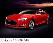 Купить «Red 2014 Tesla Model S luxury electric car outdoors on tthe road at night.», фото № 14526618, снято 14 марта 2018 г. (c) age Fotostock / Фотобанк Лори
