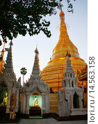 Купить «The Shwedagon Pagoda, called the Great Dagon Pagoda or the Golden Pagoda, is a 99 metres gilded pagoda and stupa located in Yangon, it lies to the west...», фото № 14563158, снято 17 декабря 2005 г. (c) age Fotostock / Фотобанк Лори
