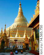 Купить «The Shwedagon Pagoda, called the Great Dagon Pagoda or the Golden Pagoda, is a 99 metres gilded pagoda and stupa located in Yangon, it lies to the west...», фото № 14565750, снято 17 декабря 2005 г. (c) age Fotostock / Фотобанк Лори