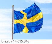 Купить «Флаг Швеции развевается на фоне голубого неба», фото № 14615346, снято 22 января 2019 г. (c) FotograFF / Фотобанк Лори