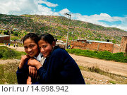 Купить «Young Colombian girls on the way home from school in Ciudad Bolívar, Bogota, Colombia, 25 August 2008. The area of Ciudad Bolívar, a shanty town in the...», фото № 14698942, снято 25 августа 2008 г. (c) age Fotostock / Фотобанк Лори