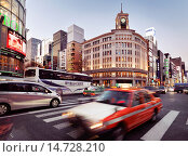 Купить «Rush hour city traffic on Chuo Dori street in front of Wako Department Store building in Ginza, Tokyo, Japan 2014.», фото № 14728210, снято 20 июня 2019 г. (c) age Fotostock / Фотобанк Лори