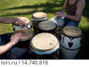 Купить «Musician Playing a Bongo Drum.», фото № 14740818, снято 5 июля 2020 г. (c) age Fotostock / Фотобанк Лори