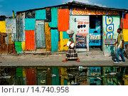 Купить «A Haitian woman walks down the street in the La Saline market, Port-au-Prince, Haiti, 14 July 2008. Every day thousands of women from all over the city...», фото № 14740958, снято 14 июля 2007 г. (c) age Fotostock / Фотобанк Лори