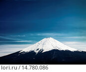 Mount Fuji under dramatic blue sky. Fujikawaguchiko, Yamanashi, Japan. Стоковое фото, фотограф Oleksiy Maksymenko / age Fotostock / Фотобанк Лори