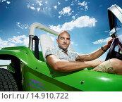 Купить «Man Sitting in Dune Buggy», фото № 14910722, снято 26 июля 2006 г. (c) age Fotostock / Фотобанк Лори