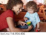 Купить «Mother and baby daughter playing with blocks», фото № 14954406, снято 30 декабря 2007 г. (c) age Fotostock / Фотобанк Лори