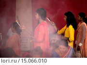 Купить «Thousands of Bangladeshi devotees celebrate the traditional festival Durga Puja, the worshipping of the Hindu goddess Durga. Common customs include the...», фото № 15066010, снято 13 декабря 2018 г. (c) age Fotostock / Фотобанк Лори