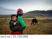 Купить «Tibetan mother carries her son in a sling on the field, Tibetan Plateau, Gansu Province, China», фото № 15130006, снято 9 октября 2012 г. (c) age Fotostock / Фотобанк Лори