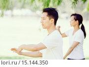 Купить «People practicing thai chi in park», фото № 15144350, снято 19 декабря 2014 г. (c) Sergey Nivens / Фотобанк Лори