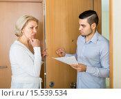 Купить «Collector and housewife near the door», фото № 15539534, снято 20 сентября 2019 г. (c) Яков Филимонов / Фотобанк Лори