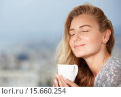 Enjoying morning coffee. Стоковое фото, фотограф Anna Omelchenko / PantherMedia / Фотобанк Лори