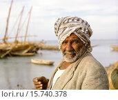 Купить «Kuwait March 1968. Kuwaiti with Dhows in Background, Sief Waterfront. He wears the typical male headdress, a ghutra, or kaffiyeh.», фото № 15740378, снято 22 февраля 2015 г. (c) age Fotostock / Фотобанк Лори