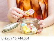 Купить «Girl snacking sweets between meals», фото № 15744034, снято 25 июня 2019 г. (c) age Fotostock / Фотобанк Лори