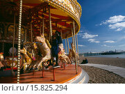 Купить «Child and mother sitting on a carousel on the seafront», фото № 15825294, снято 23 июля 2008 г. (c) age Fotostock / Фотобанк Лори
