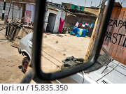 Купить «Plastic barrels, used for water storage, are seen in the rear mirror of a water truck distributing drinking water in Pachacútec, a desert suburb of Lima...», фото № 15835350, снято 20 января 2015 г. (c) age Fotostock / Фотобанк Лори