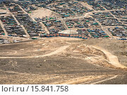 Купить «A sprawling settlement of houses and wooden shacks is seen on the dusty hillsides of Pachacútec, a desert suburb of Lima, Peru, 24 January 2015. Although...», фото № 15841758, снято 24 января 2015 г. (c) age Fotostock / Фотобанк Лори